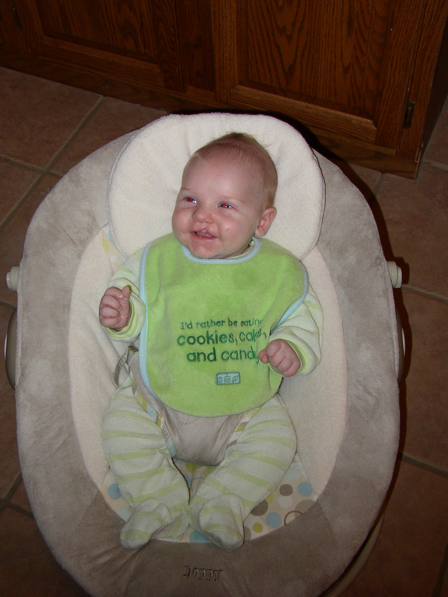 Michael Leahs Continuing Saga2009 Hey Baby Busy Bee Round Bib Hes Getting More Interested In His Toys And Grasping Them Trying To Suck On A Few He Really Likes Bat Around The Hanging Objects